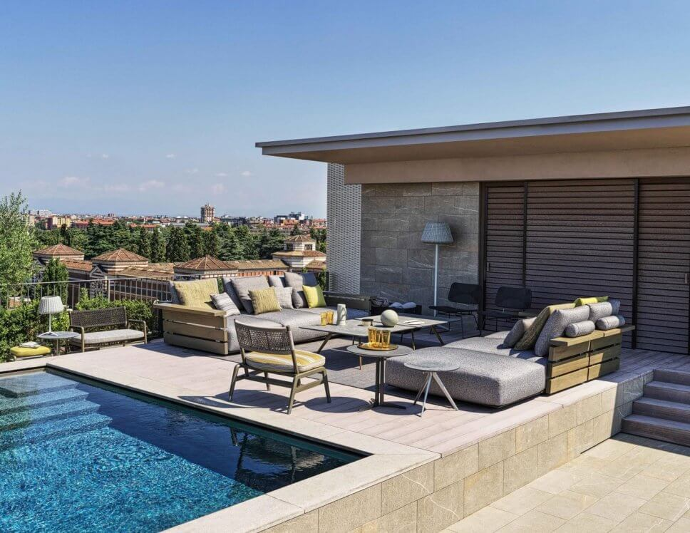 Modernes Gartensofa auf Terrasse neben Pool